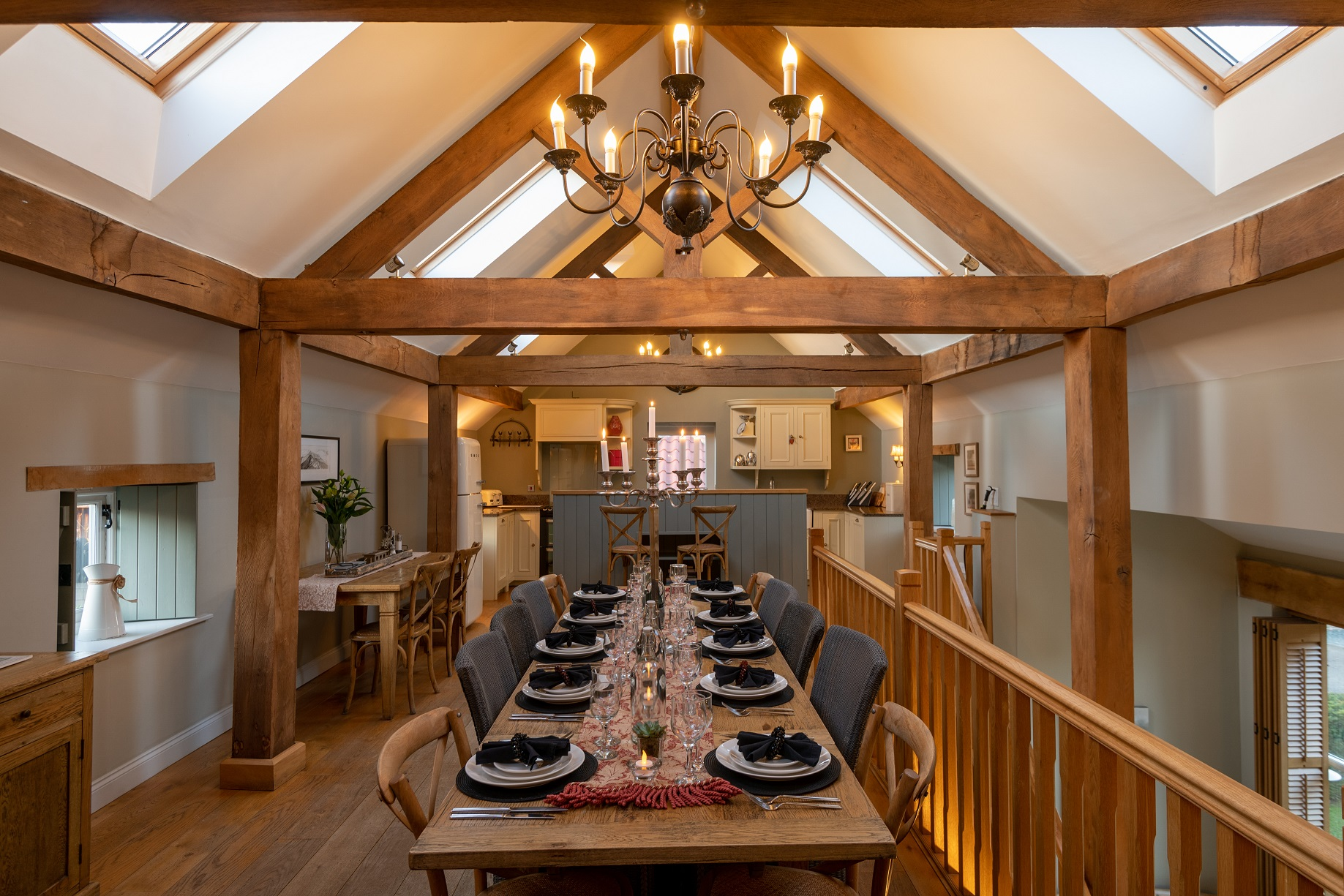 Dining table in the Hay Barn at The Dovecote Barns set with 8 places