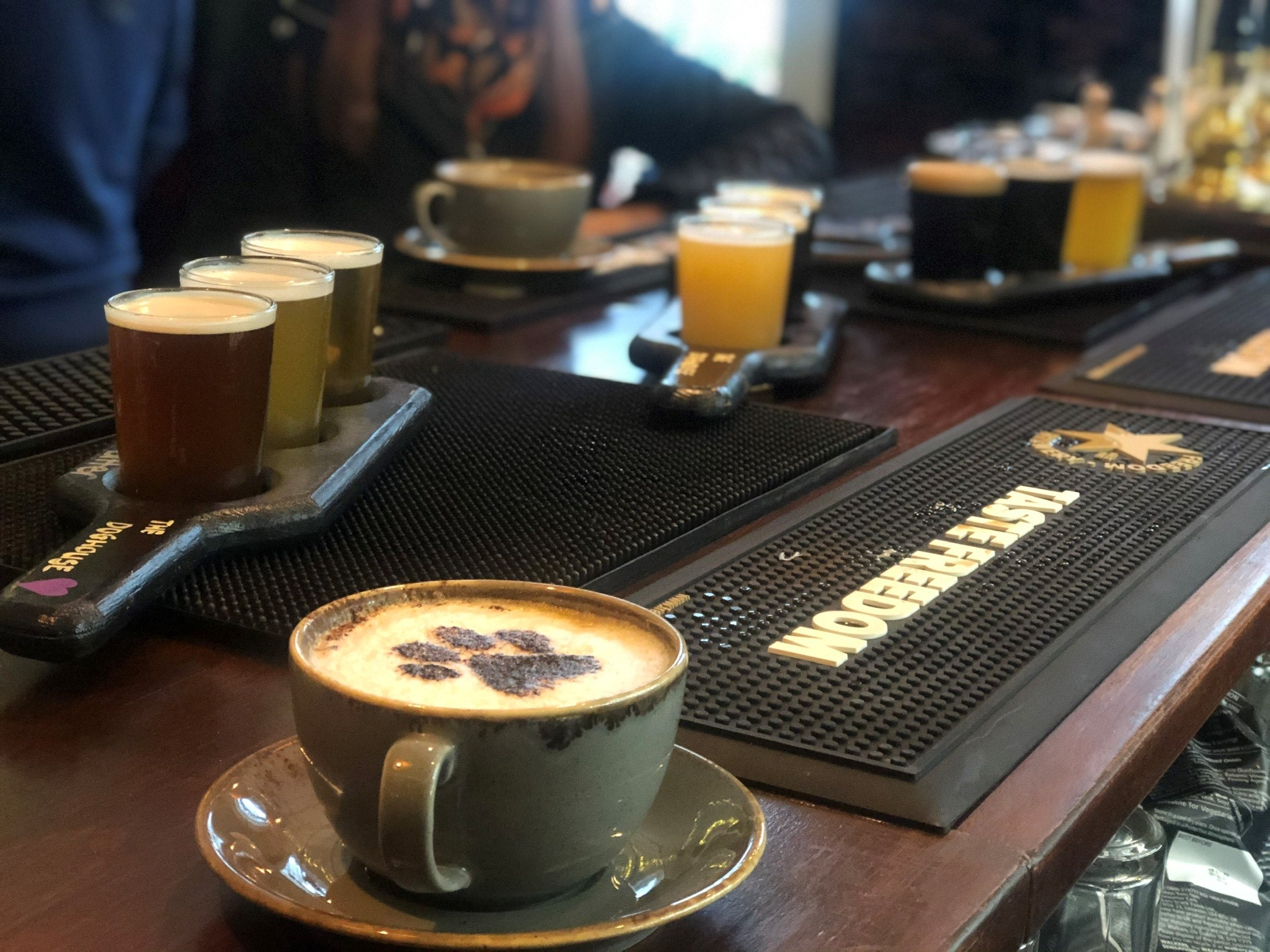 Coffee and glasses of beer on the bar at The Doghouse Selby
