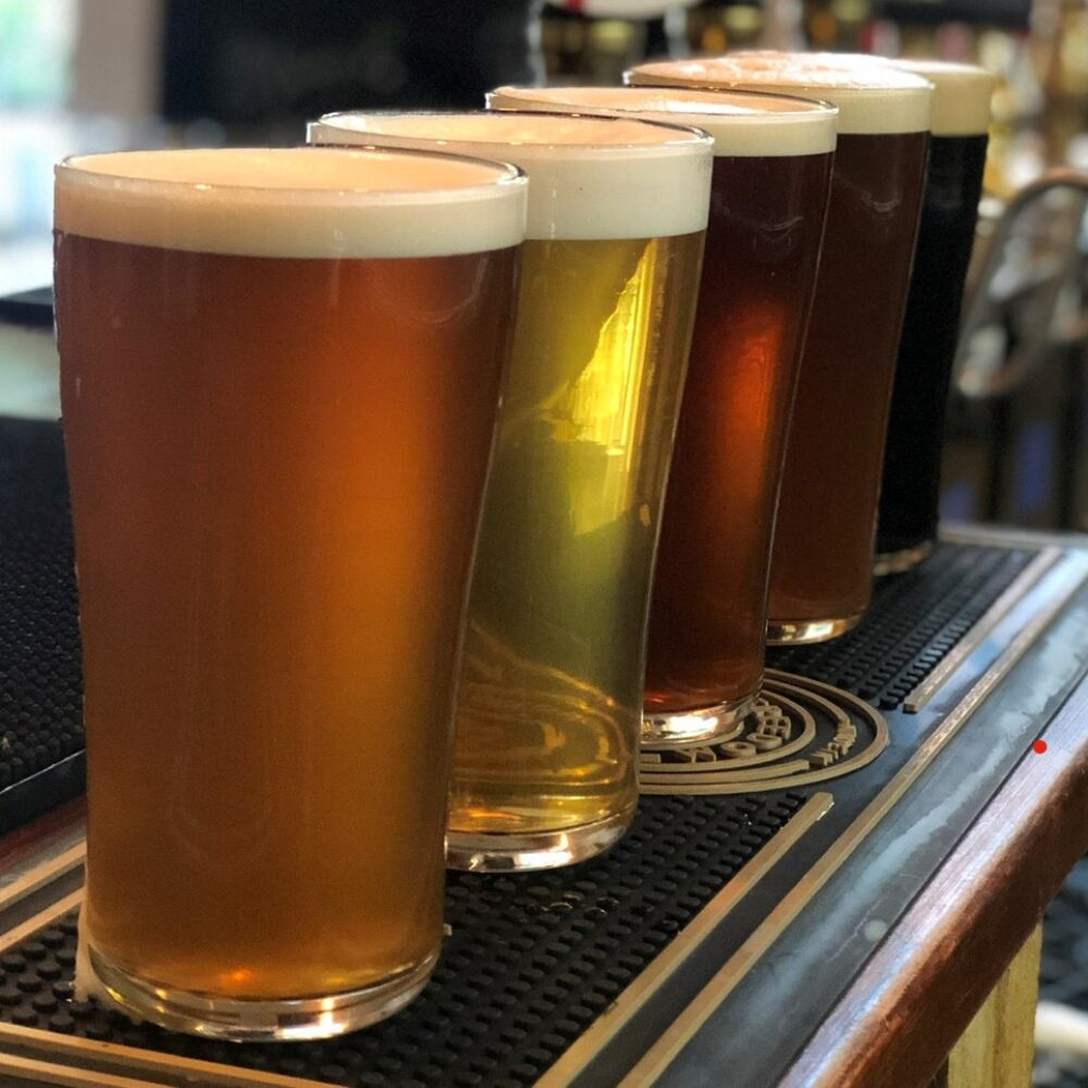 Four pints of beer lined up on the bar at The Doghouse Selby
