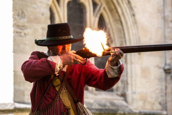 Reenactor firing a musket