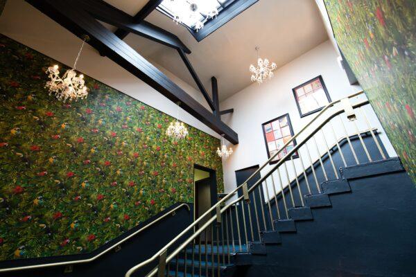 Image looking up at the staircase at River Mills Ballroom