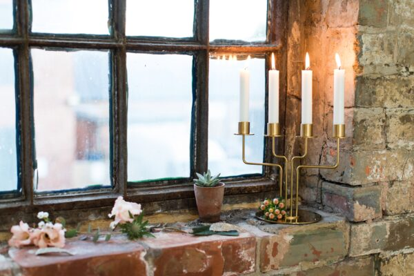 Candles and decorations on the windowsill