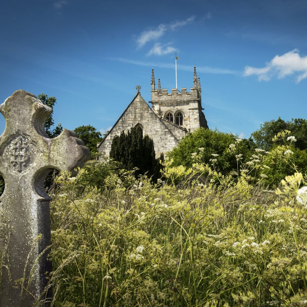Church and stone cross in Sherburn in Elmet