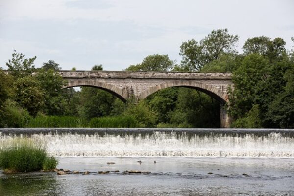 View along the river of Tadcaster Viaduct