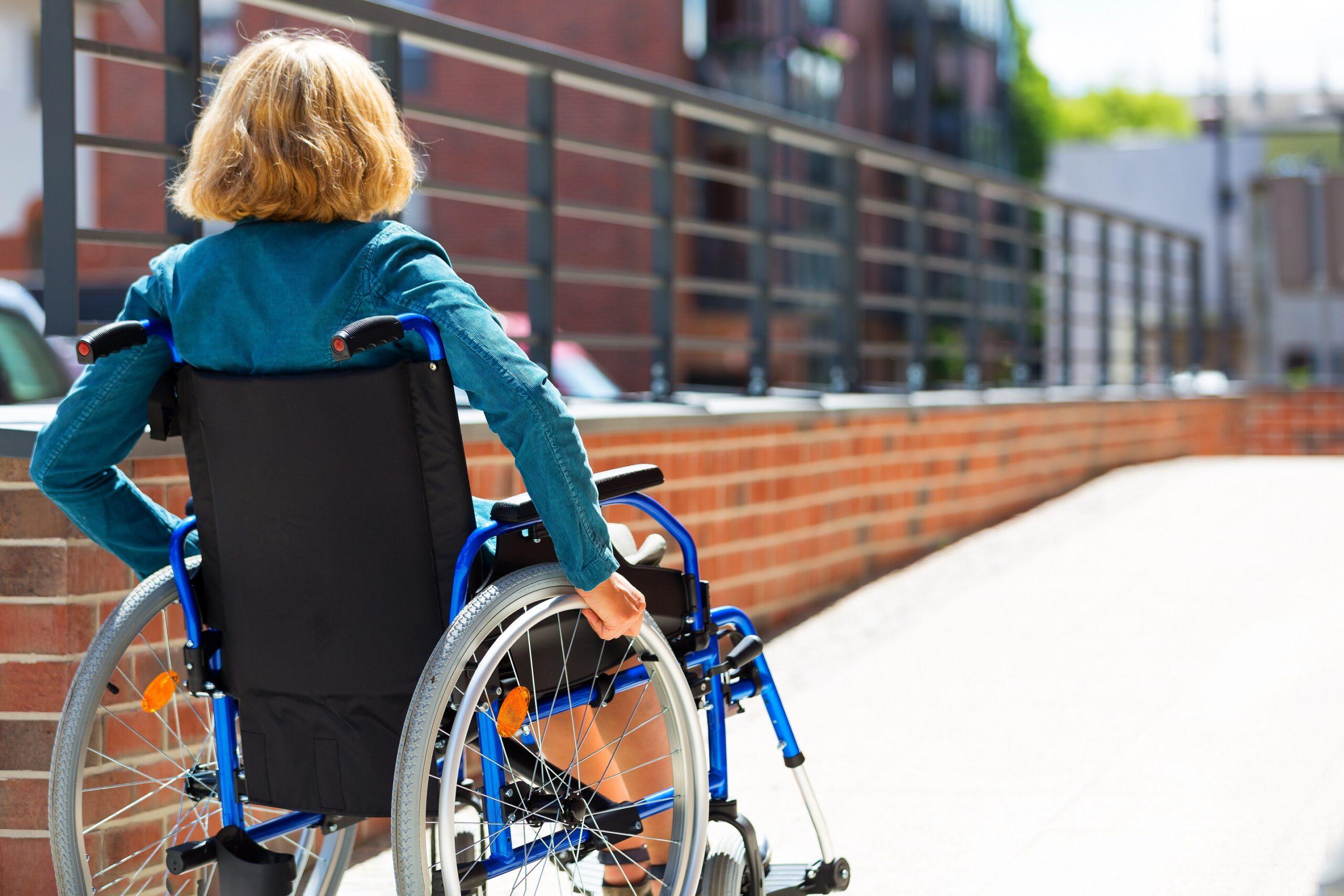 Woman in wheelchair accessing a ramp
