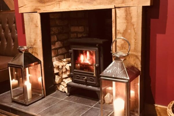 The fireplace and lit fire at The Castle Inn in Cawood