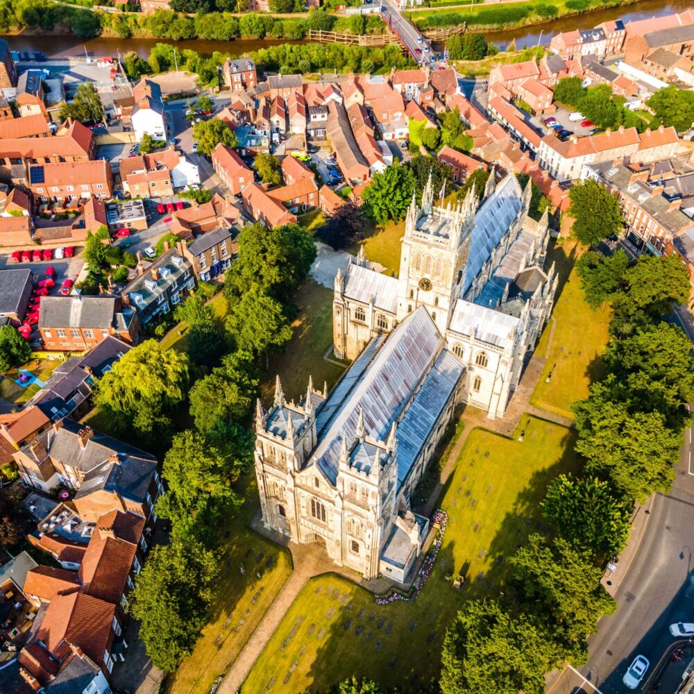 Aerial image looking down on Selby Abbey and its grounds