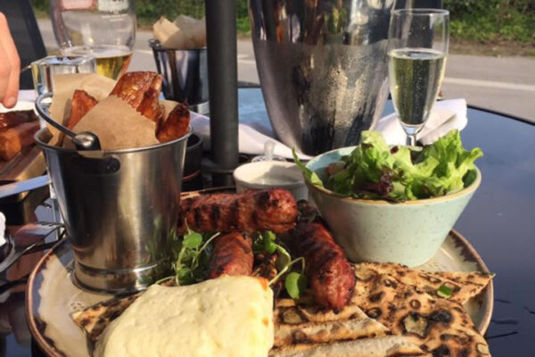 Food and Champagne served outside at The Drover's Arms in Skipwith