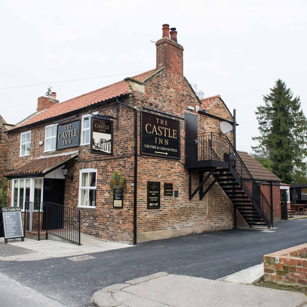 A side view of The Castle Inn in Cawood and its entrance