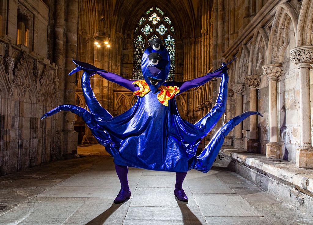 Performer dressed as a purple alien in Selby Abbey