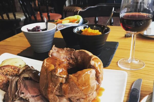 Sunday lunch, Yorkshire pudding and glass of red wine served at The Castle Inn Cawood