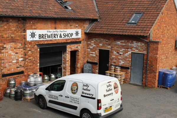 The entrance of Jolly Sailor Brewery and their van